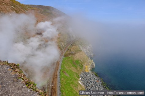 Steam, smoke and sea mist mark the passing of 461 at Bray Head.