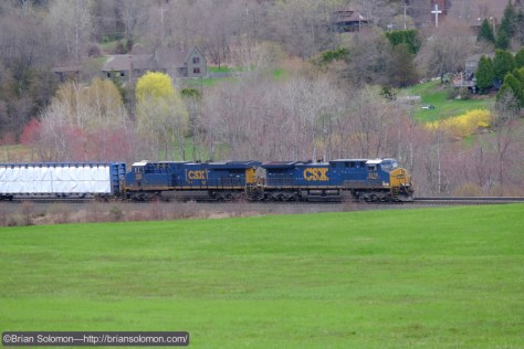 A pair of CSX GE's lead a westward carload freight passed CP79. The eastward intermodal train would have to wait. Exposed with a Fujifilm X-T1 with 18-135mm lens set at 135mm.