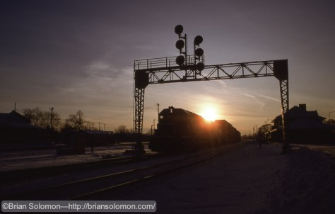 Phase 1. As pictured with an eastward Conrail doublestack train at Elkhart, Indiana.