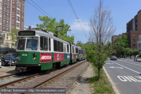 An outbound MBTA Green Line train on the Beacon Street line near Coolidge Corner. Lumix LX7 photo.