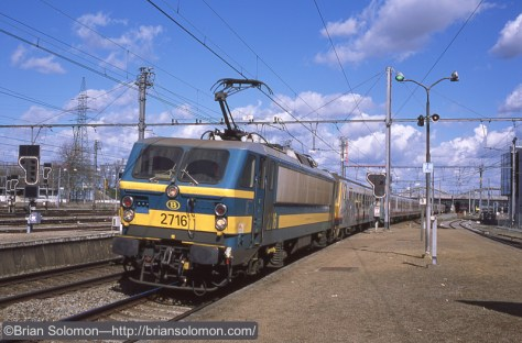 At the north end of a station platform I exposed this classic view of a Class 27 SNCB electric leading a passenger train. exposed on Provia 100F with a Canon EOS 3 fitted with 40mm pancake lens. Slide digitized with a Epson V600 flatbed scanner.