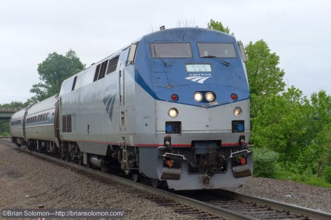 Tight view of Amtrak P42 number 111 leading train 493 as it approaches Windsor Locks, just before 11 am today.