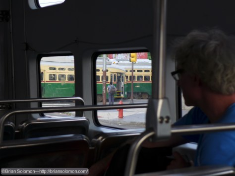 Sean watching the trolleys as we take a corner. Lumix LX7 Photo.