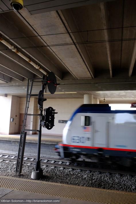 An Amtrak Regional train blitzes the station.