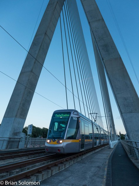 Inbound LUAS tram glides across the Dargan Bridge at Dundrum. Exposed as a RAW file with my Lumix LX7, white balance set to 'daylight', contrast adjusted in post processing.