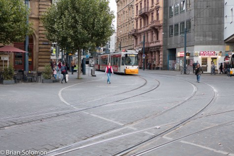 Lumix LX7 of a tram in Mainz. Here I've composed the photo to emphasize the track work and street paving. LX7 photo.