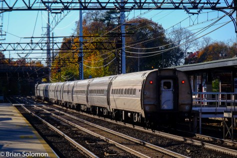 Amtrak 163 races into the evening sun at Green's Farms, CT.