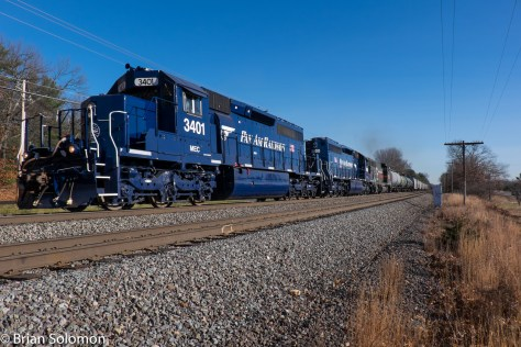 Nice clean locomotives work west on heavily blasted track at Shirley, Massachusetts on November 18, 2015.