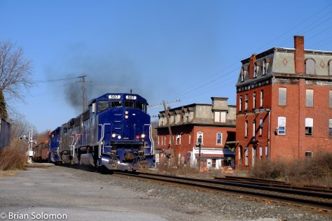 Pan Am Railways 507 leads symbol freight RJED working east from the CSX interchange at Rotterdam Junction, New York. Seen here on the old B&M at Hoosick Falls, New York, just before noon on November 16, 2015. FujiFilm X-T1 photo.