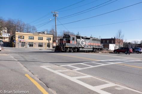 The locomotive crosses Main Street in Gardner, near the corner of Chestnut.