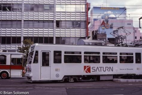 A Saturn advertisement graces a streetcar in Okayama, Japan in April 1997.