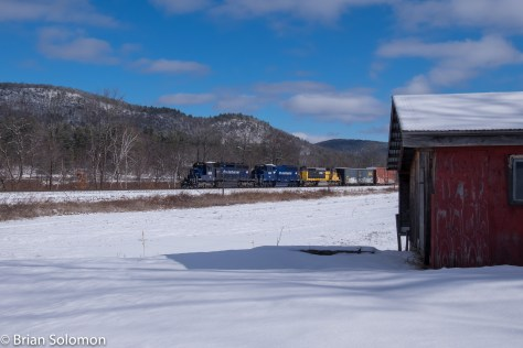 EDRJ catches the sun crossing a field freshly covered with snow near Buckland, Massachusetts. FujiFilm X-T1 photo.