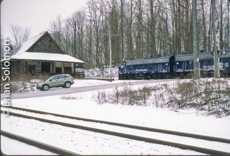 Among muy favorite photos from my day-long pursuit of the elusive Pan Am Railways office car train is this view at Eaglebridge that shows the classic old Boston & Maine station, the nose of a westward freight and tracks on two levels. Exposed on Fujichrome Provia 100 with a Canon EOS-3 with 40mm lens.