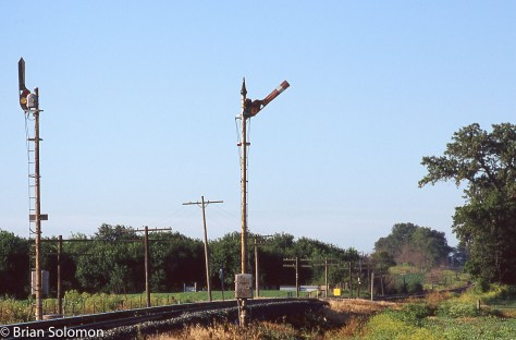 General Railway Signal upper quadrant semaphores with Model 2A top of mast mechanisms on CSX's former Monon near Romney, Indiana on June 23, 2004. Exposed on Fujicrome with a Nikon F3 and 180mm lens.