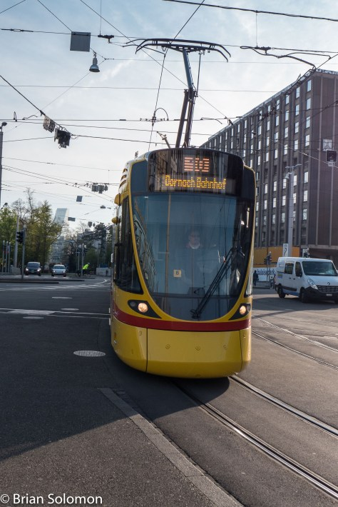 This side-lit view favors the tram's modern profile.