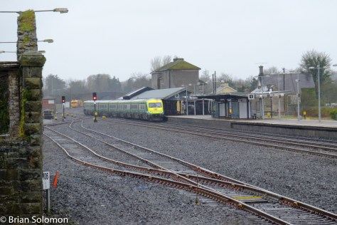Limerick Junction cross the Cork line at grade. There's a Dublin to Cork Mark4 set heading down road.