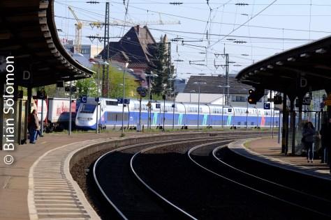 An SNCF TGV approaches Rastatt on DB rails.
