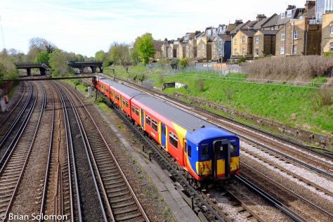 A South West Trains emu clatters along south of Clapham Junction.