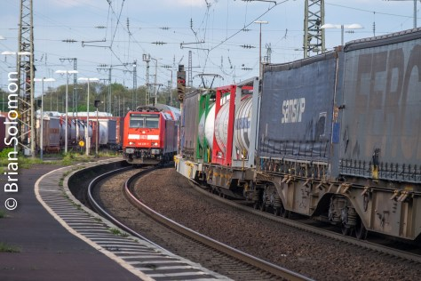 A regional passenger train passes a freight.
