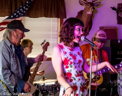Three LeBeaus (Dennis on bass, Tommy on drums, and Paul on guitar) backing Rosie Porter.