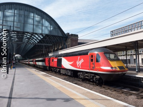 In the shadow of Mallard; a Virgin HST idles at London's Kings Cross on 3 May 2016. Lumix LX7 photo.