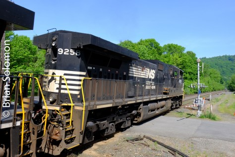 Trailing view of Norfolk Southern DASH9-40C 9258 at Shelburne Falls. (That's the Shelburne Falls trolley museum at the right).