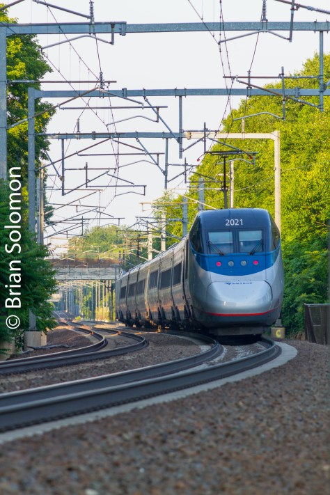 A trailing view of Amtrak's Boston-bound Acela (train 2168) at the same curve in Madison, Connecticut.