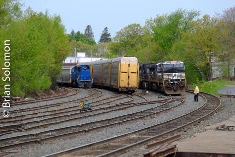 After about an hour of patient waiting, the P&W crew was on board and nearly ready to proceed south. I made this slightly elevated view from a parking lot on the site of the old Gardner Station. In the yard is one of P&W's leased SD60s and some auto racks for interchange.