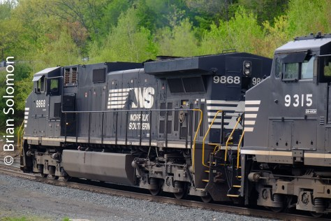 Trailing view of the leading locomotive easing down the P&W toward the Route 2 underpass.