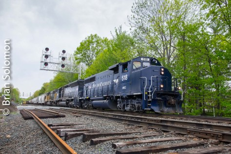 Pan Am Railway's freight EDPO (East Deerfield to Portland, Maine) crawls through the worksite at Westminster. Consider my use of foreground and background. Notice the old infrastructure and the new. Exposed with a Fuji XT1.