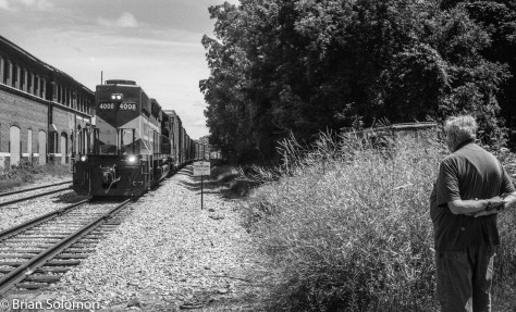 John Gruber looks on while Wisconsin & Southern 4008 switches at Baraboo. Exposed on Ilford Pan F using a Leica 3A rangefinder camera fitted with a Nikkor f3.5 35mm lens.