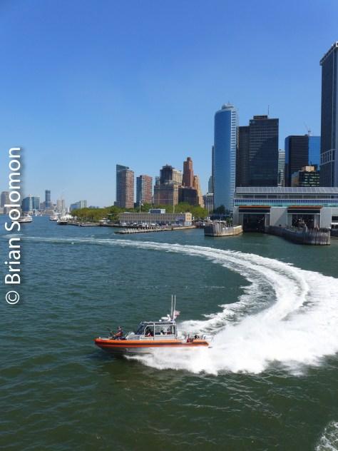 US Coast Guard escort across New York Harbor.