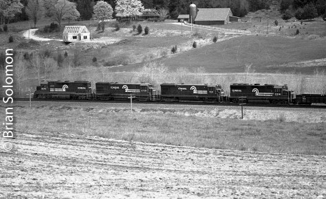 Conrail's SEPW (Selkirk to Providence & Worcester) roars east through the Quaboag Valley east of Palmer on May 6, 1984. The magic combination: filtered Spring light; Plus-X film exposed using a Leica M3 with 90mm Elmar fitted with an orange filter. Processed in Microdol-X.
