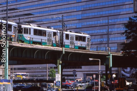 Sometime after I made this slide of Green Line cars on the El, MBTA discontinued operation of the old elevated line in front of North Station. Today the scene is completely changed. Exposed on Fujichrome using a Nikon.