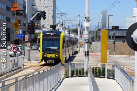 A pair of new Kinkisharyo cars approach the Gold Line station at Little Tokyo.