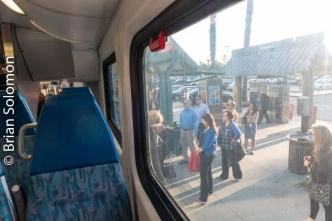 Passengers board a morning train.