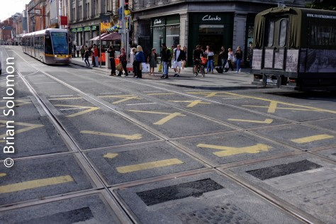 New square crossing at Abbey Street and O'Connell Street. Red Line tram waiting at the lights. FujiFilm XT1 digital camera.