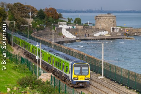 Irish Rail 29000-seres train passes Seapoint, Dublin on 25 October 2016.