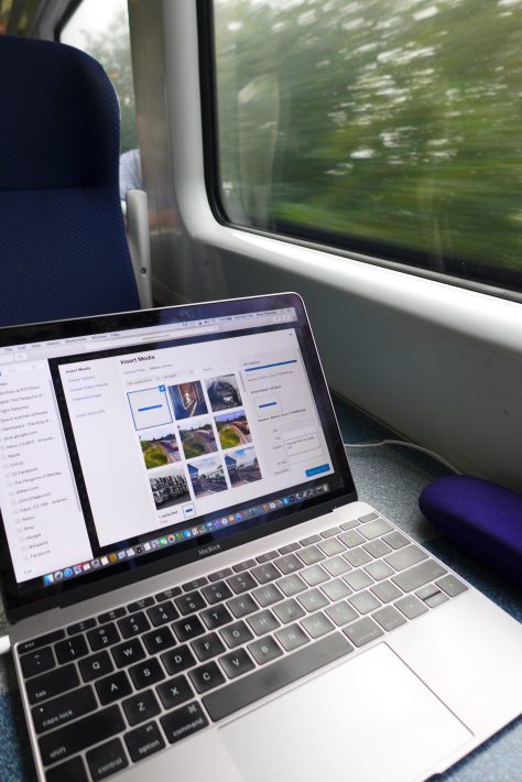 The Medium is the Message—My laptop on the train as I'm producing this post-the file was downloaded directly from the card to WordPress.