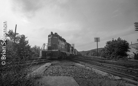 Grand Trunk GP9 4442 wearing black and orange paint leads a freight across Conrail's former Boston & Albany mainline. Exposed on black & white film using a Leica 3C fitted with a 21mm Super angulon.