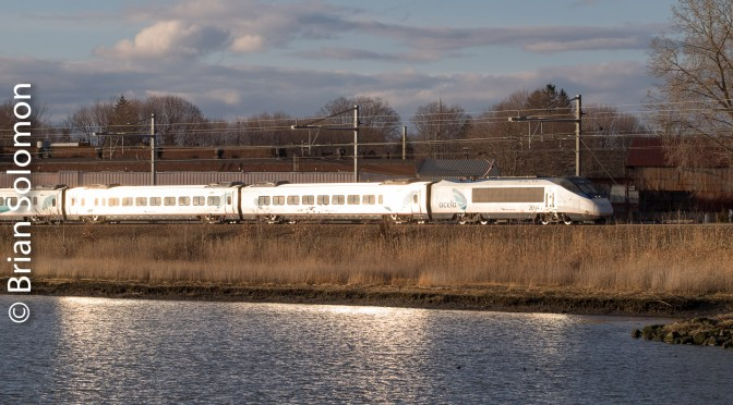 Amtrak's Acela Express train 2252 catches the glint at Branford, Connecticut.