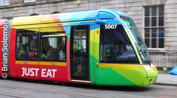 Multi-coloured Tram Glides Down Harcourt Street.