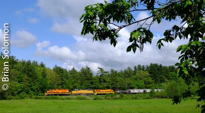 Orange Locomotives on the Roll—611 works North.