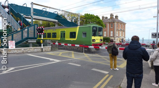 Irish Rail DART crosses at level crossing in Bray.
