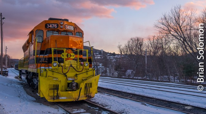 NECR 3476: Orange Locomotive in Winter Light.