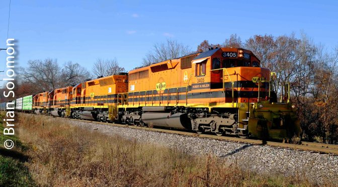 Four Orange SDs—New England Central's 611 at Three Rivers.