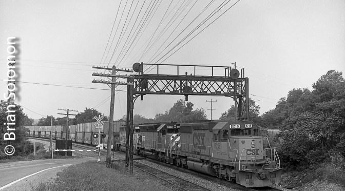 CSX SD40-2 on the old Erie: Delaware & Hudson Sealand Train, Attica, New York.
