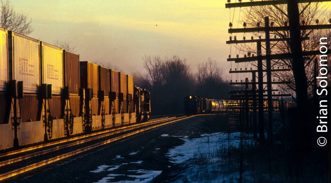 30 years ago today: Conrail Meet at Sunrise on the Water Level Route near Batavia, New York.