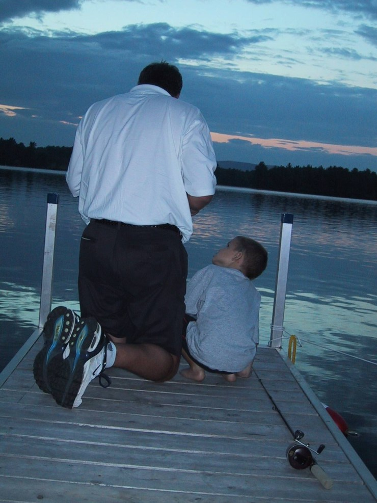 Nick with Uncle Rob on dock_ 8-03