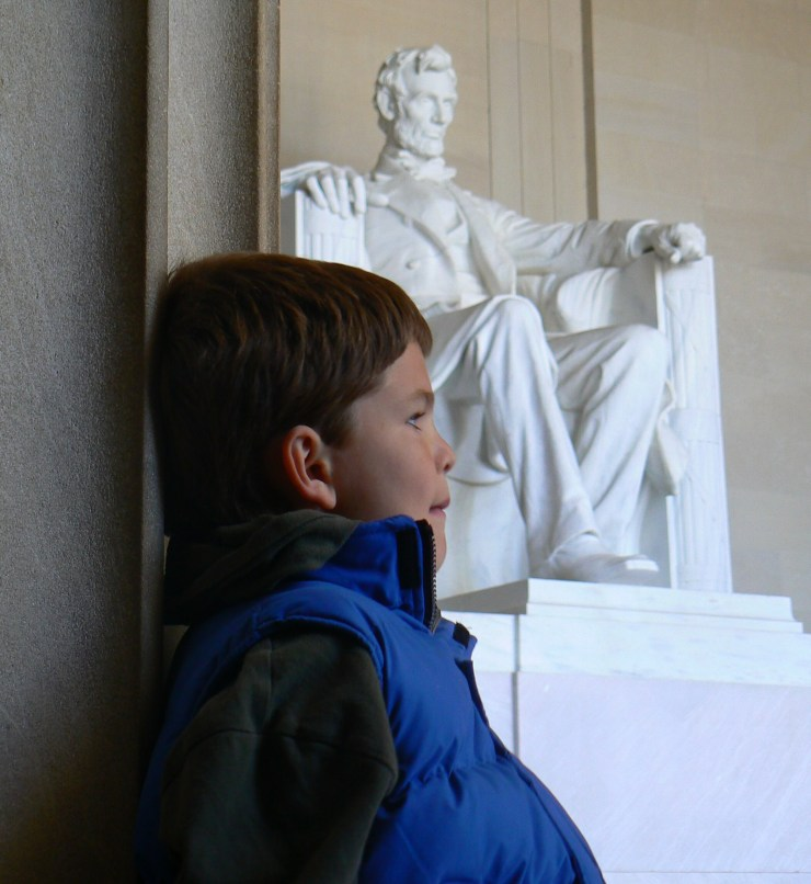 Sam with Lincoln; leaning on post; 11-07